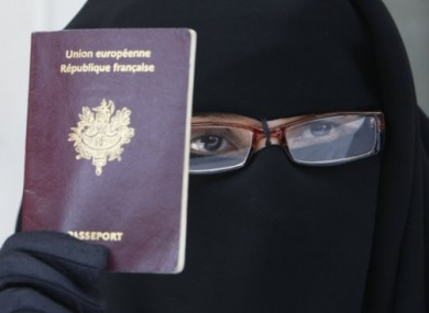 French woman Najat shows her European passport, as dressed in a niqab.