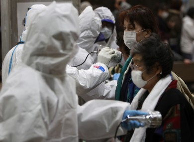 Evacuees are screened for radiation contamination at a testing centre in Koriyama, a city in the same prefecture as the Fukushima nuclear plant.