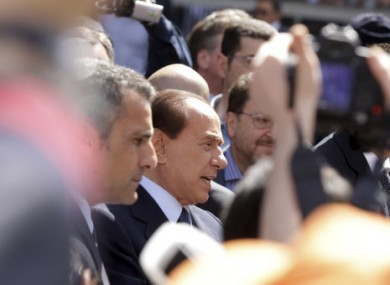 Silvio Berlusconi speaking to his supporters outside a court in Milan today.