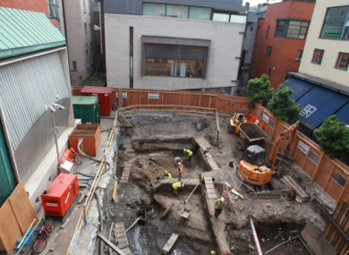 Archaeologists digging at the site in Meeting House Square