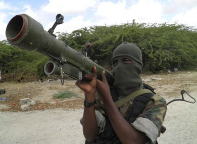 An al-Shabab fighter poses for a photo in late 2010.