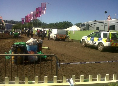 Police on the scene backstage at Glastonbury this afternoon.