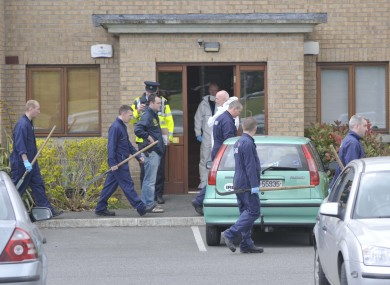 Gardaí at the scene of the shooting in Coolock yesterday