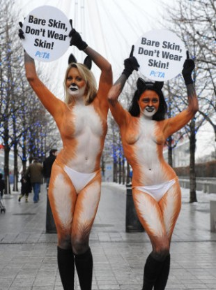 Monica Harris (right) and Victoria Eisermann pose for a PETA campaign against wearing fur.