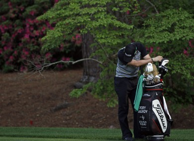 Rory takes a moment to himself after blowing his lead during the final round of the US Masters at Augusta.