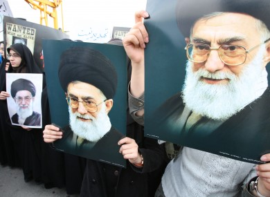 Iranian students hold posters of supreme leader Ayatollah Ali Khamenei