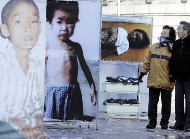A South Korean couple look at pictures of North Korean famine victims at an exhibition in Seoul in 2005.