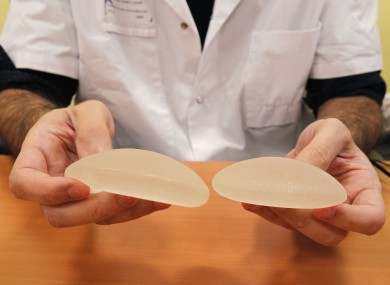 A plastic surgeon hold silicone gel breast implants made by French company PIP, which may be unsafe.