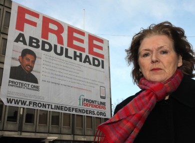 Mary Lawlor of Frontline Defenders in front of the banner bearing Abdulhadi's image on Earlsfort Terrace/St Stephen's Green