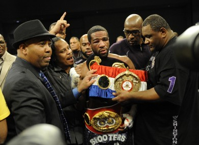 Mustafa Ameen close to the victorious Lamont Peterson