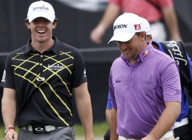 Rory McIlroy and Graeme McDowell share a joke yesterday.