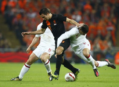 Robin van Persie battles for the ball with England's Scott Parker (left) and Chris Smalling.