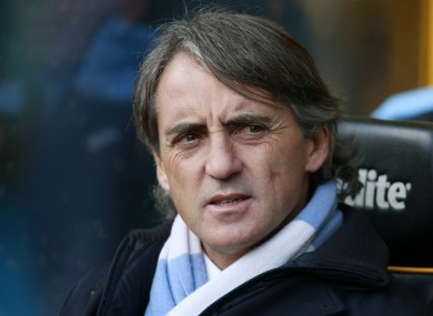 Mancini takes in the action at Molineux.