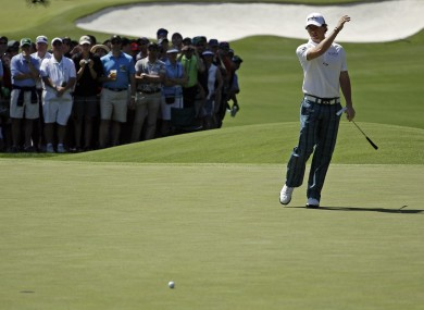 McIlroy acts to a missed putt on the third green.