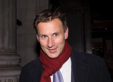 British Culture Secretary Jeremy Hunt leaves his office in London yesterday as the pressure mounted.