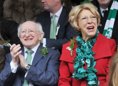 President Michael D Higgins and his wife Sabina at the St Patrick's Day parades: Irish people rank 10th in the world for happiness, according to a new UN report.