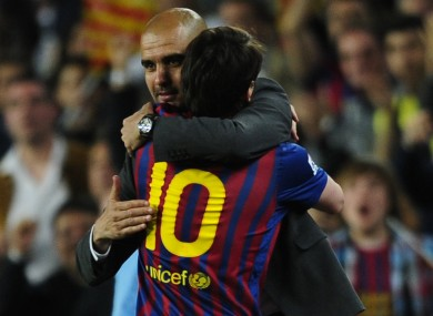 Messi embraces departing coach Pep Guardiola.