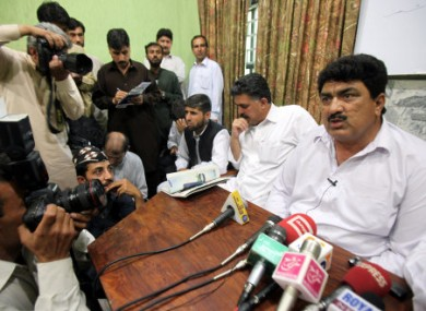 Jamil Afridi, right, brother of Shakil Afridi, speaks at a news conference in Peshawar on Monday.