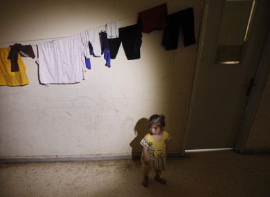 A Syrian refugee girl in the school corridor where she is temporarily living in a Lebanese-Syrian border town