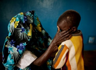 A mass rape victim from Fizi, South Kivu and her young son. Her identity has been concealed for security reasons in this Feb 2011 photo.