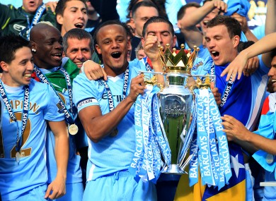 Vincent Kompany lifts the Premier League trophy.