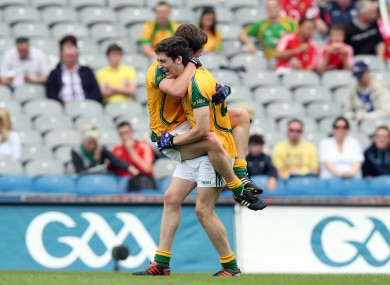 Patrick Kennelly of Meath celebrates with a team mate after his county's win.