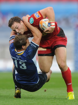 George North barges through Brendan Macken.