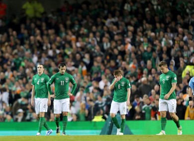 The Irish players looking dejected.