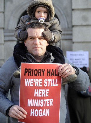 Darren Kelly and his 3 year old son Evan at a Priory Hall protest last December.