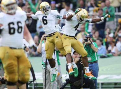 George Atkinson III (left) of Notre Dame celebrates scoring a touchdown with teammate Theo Riddick.