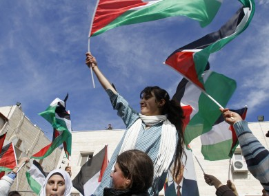 Palestinian schoolgirls wave Palestinian flags during a rally supporting the Palestinian UN bid for observer state status, in the West Bank city of Ramallah today
