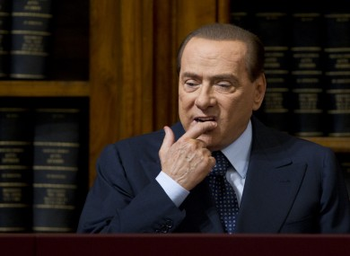 Silvio Berlusconi looking unhappy
