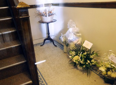 Flowers addressed to the parents of Rehma Sabir are seen in the entryway of their apartment building in Cambridge, Massachusetts