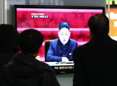 People watch TV showing North Korean leader Kim Jong Un at Seoul Railway Station in Seoul