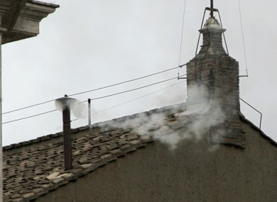 White smoke billows from the chimney atop the Sistine Chapel, at the Vatican, in this April 19, 2005, file photo, to announce the election of Pope Benedict XVI.