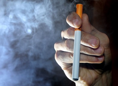 A person smokes an electronic cigarette, or e-cigarette.