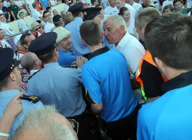 Referee Joe McQuillan is confronted by Kildare supporters after the game.