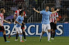 Dzeko hits howitzer and a howler in Manchester City mud-fight victory