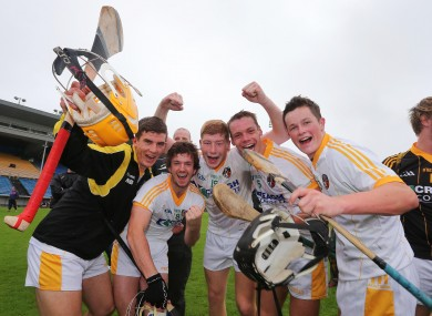 Antrim players celebrate at the final whistle last Saturday.