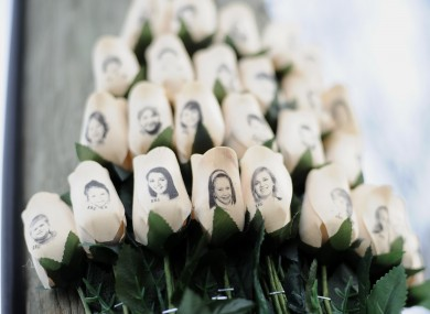 Roses printed with the faces of victims of the Sandy Hook school massacre near the school earlier this year.