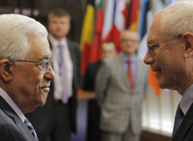 European Council President Herman Van Rompuy, right, talks with Palestinian President Mahmoud Abbas, prior to a meeting at the European Council.