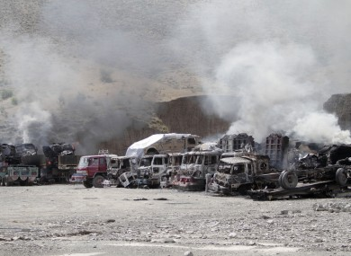 NATO supply trucks burn following an attack by Taliban militants on a US base in the Torkham area near the Pakistan-Afghanistan border in Jalalabad in September.