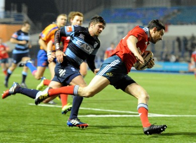 Felix Jones of Munster runs in to score a try.