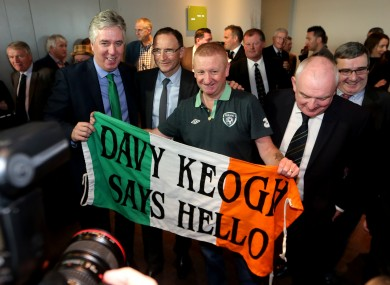 Republic of Ireland manager Martin O'Neill and FAI CEO John Delaney with fan Davy Keogh.
