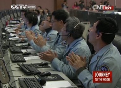 Scientists at the control centre applaud as the spacecraft touches down
