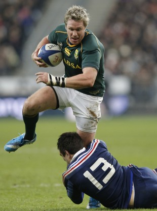 Jean de Villiers is tackled by Floria Fritz of France.