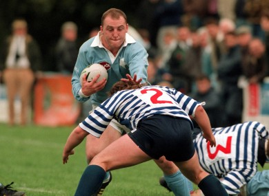 Keith Wood of Garryowen is tackled by Blackrock's Shane Byrne in 1994.