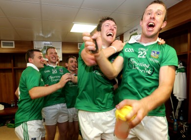 Limerick's Seamus Hickey and Niall Moran celebrate in the dressing room after the Munster final.