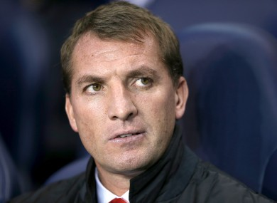 Top man: Rodgers' work has paid off at Anfield in his second season.