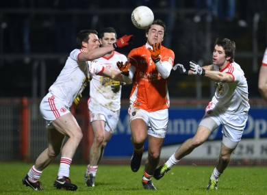 Armagh's Andy Mallon surrounded by Tyrone players.